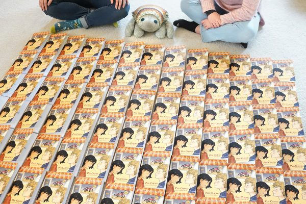 Author Peg Cheng and illustrator Erin Kubo sign the first 100 copies of The Contenders.