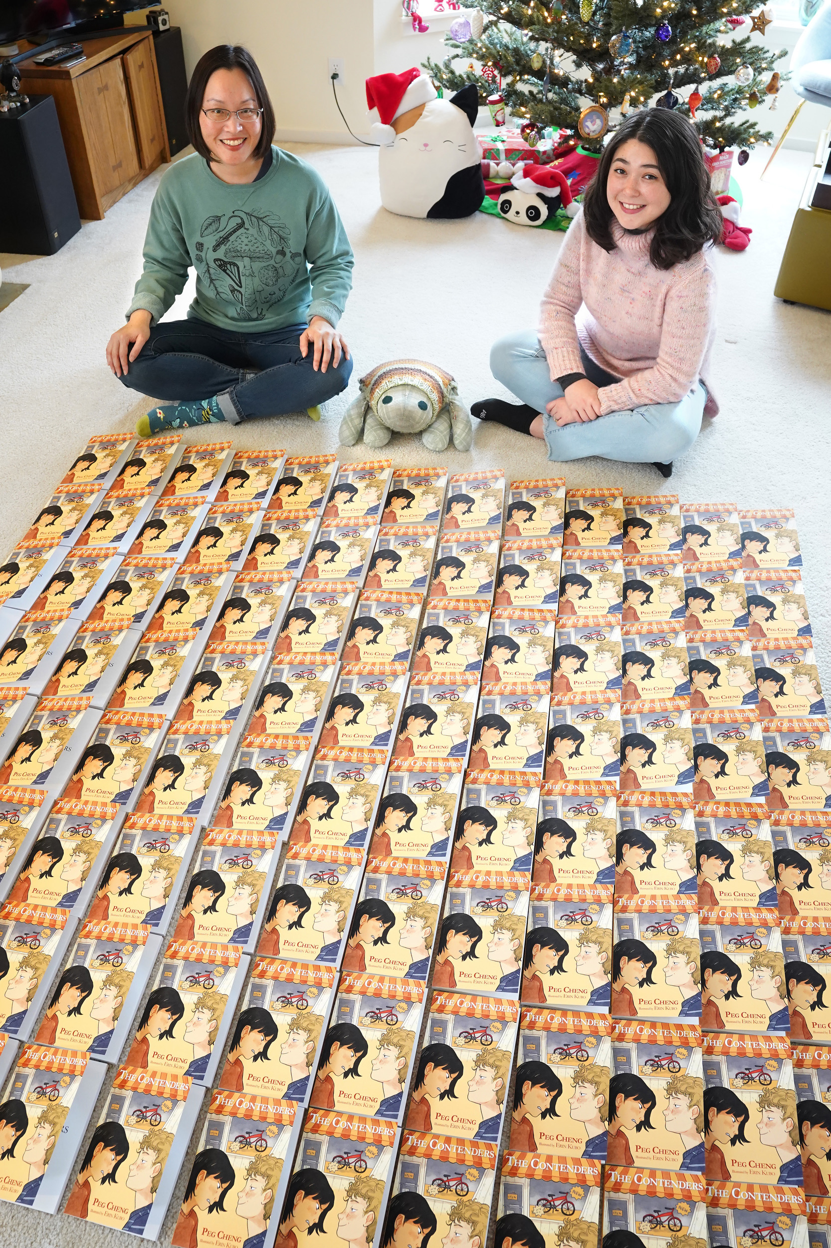 Author Peg Cheng & illustrator Erin Kubo sign the first 100 copies of The Contenders.